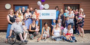 A group of people standing outside BCRM